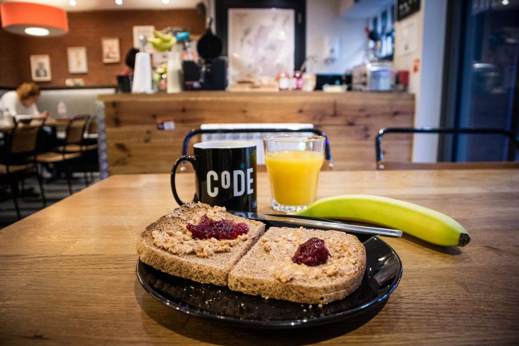 Toast with peanut butter, orange juice and a banana for breakfast at Code pod hostel in Edinburgh