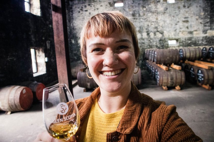a woman drinking Glen Scotia whisky at the distillery warehouse in Campbeltown