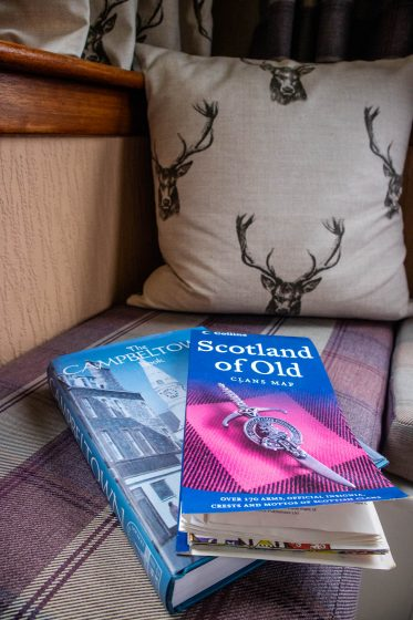 Scotland books on a tweed bench