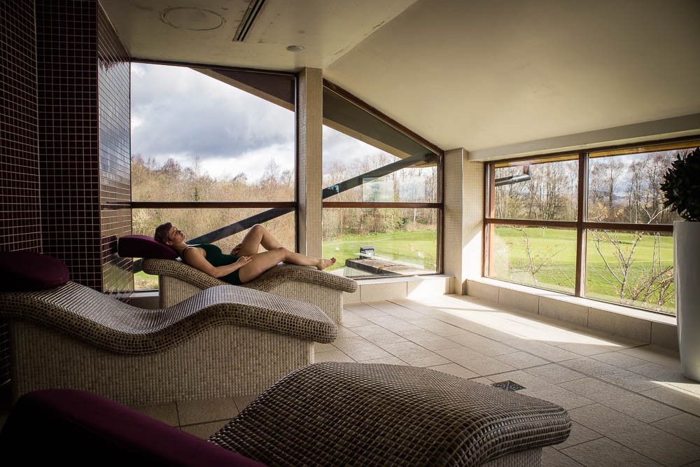 A woman relaxing at Carrick Spa at Cameron House at Loch Lomond.