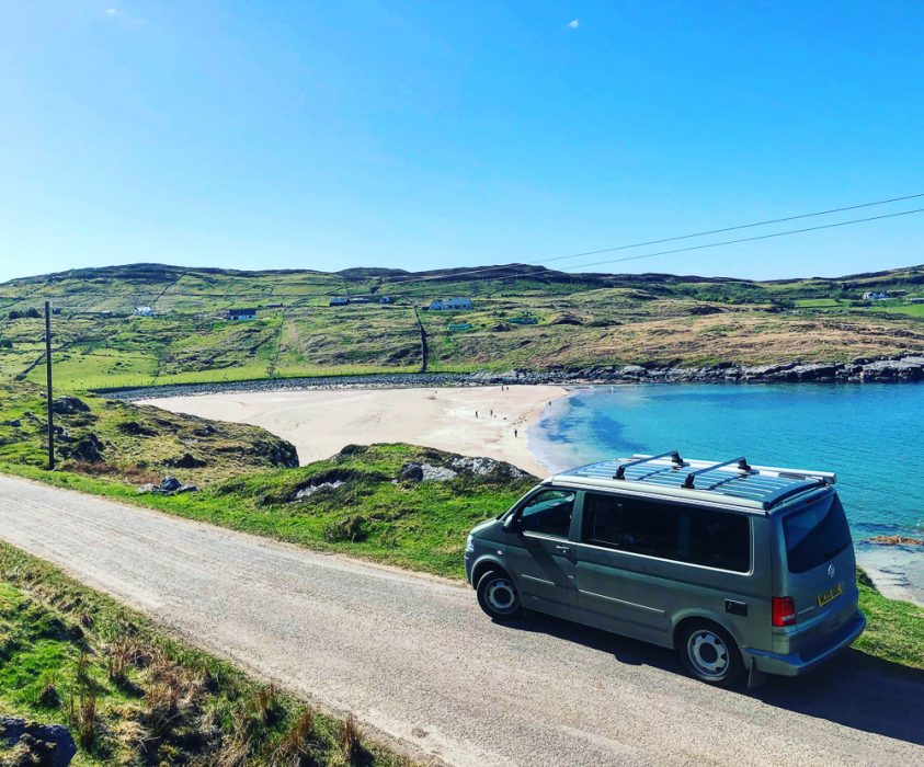 A campervan by a Scottish beach