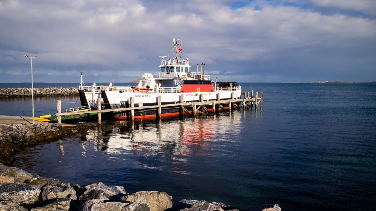 A CalMac ferry in the harbour of Eriskay.