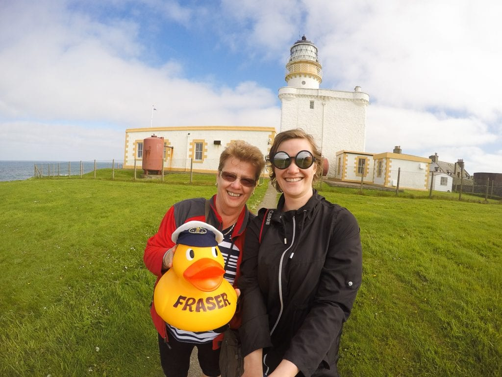 My mum and I with the mascot of the Museum of Scottish Lighthouses, rubber duck Fraser. Behind us you can see the old Kinnaird Head lighthouse.