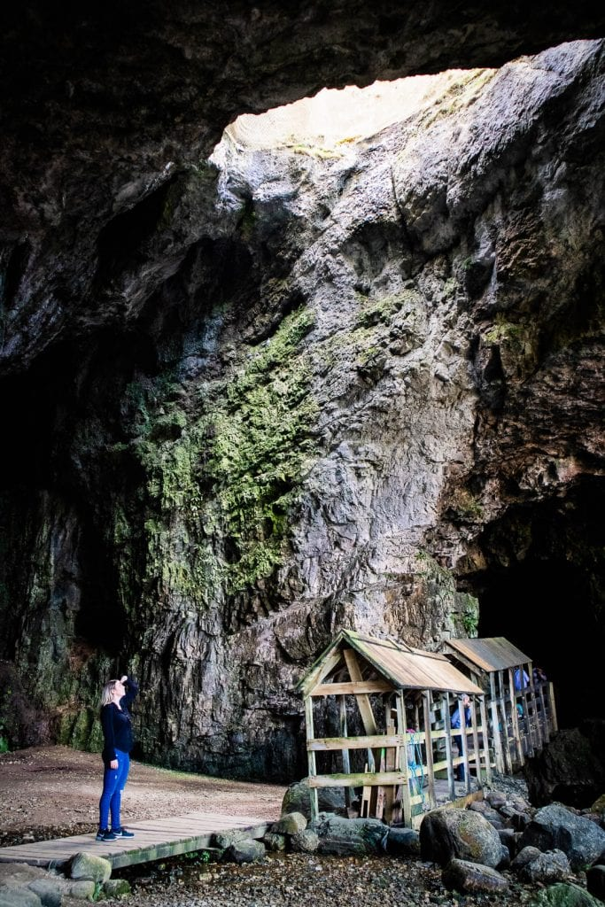 North Coast 500: A woman standing in Smoo Cave