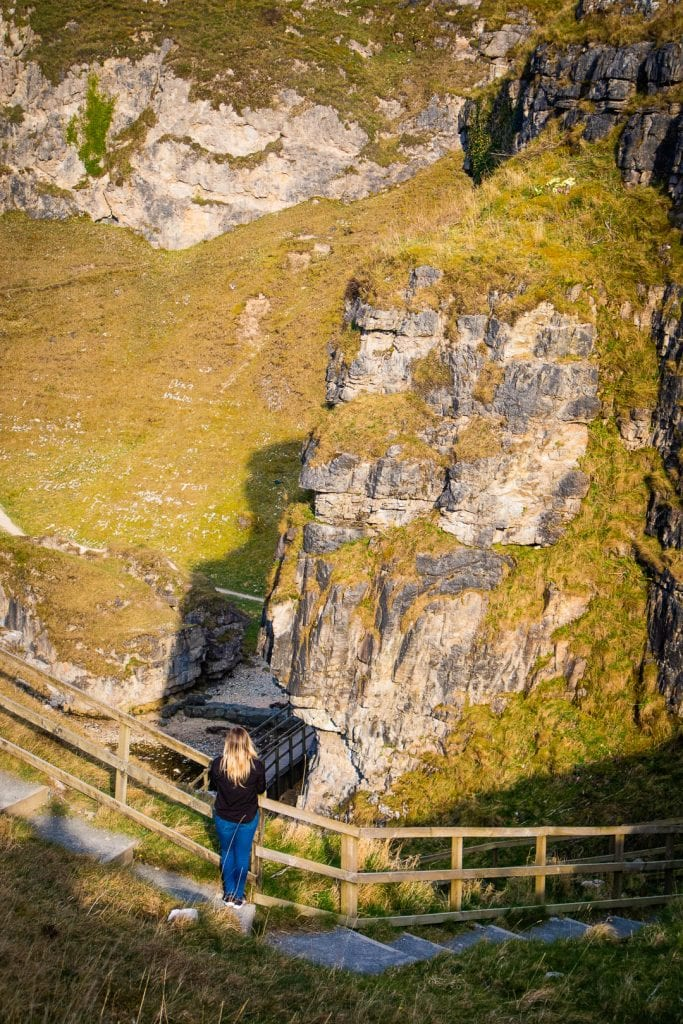 North Coast 500: A woman walking down the stairs to Smoo Cave