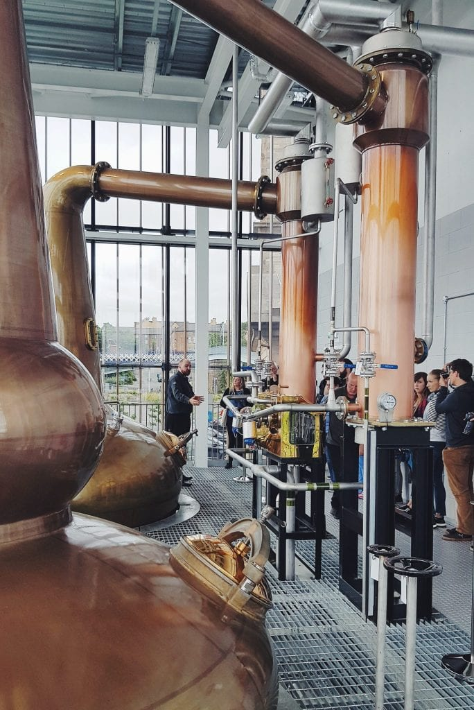 The beautiful still room at the Clydeside Distillery with two big copper stills.