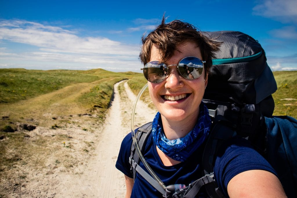 Day 2 Girl walking on South Uist - Hebridean Way in 12 days