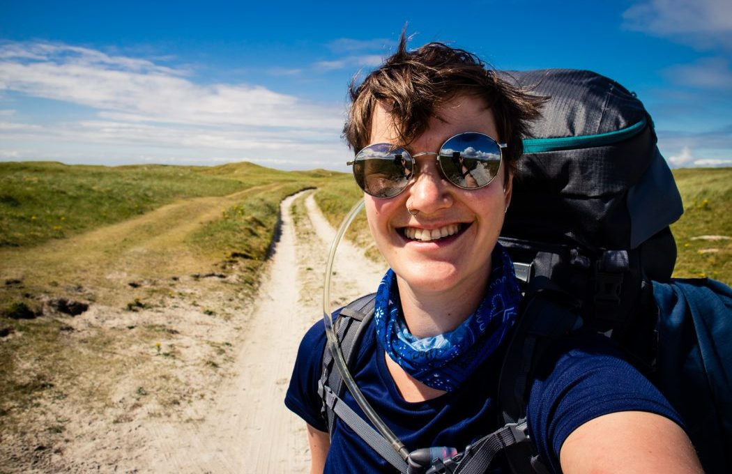 Day 2 Girl walking on South Uist - The best trekking backpacks & their must-have features