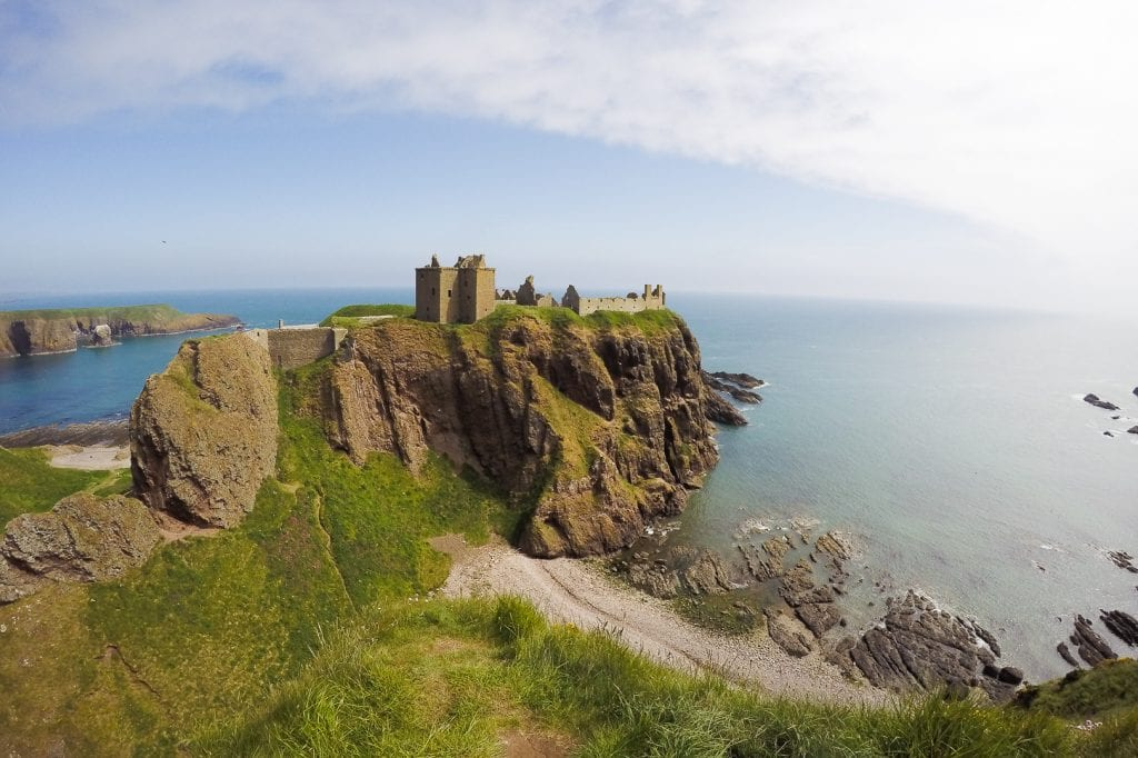 Dunnottar Castle is a medieval ruined fortress near the town of Stonehaven. It sits on a rock, overlooking the ocean, along the coastline of Aberdeenshire.