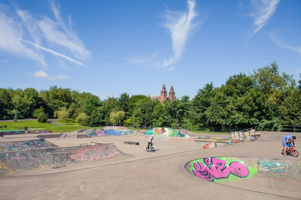 A skate park at Kelvingrove Park with Kelvingrove Museum and Art Gallery in the background.