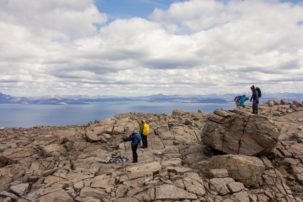 This photo shoes a group of hikers in the Cuillin mountain ridge on the Isle of Rum.