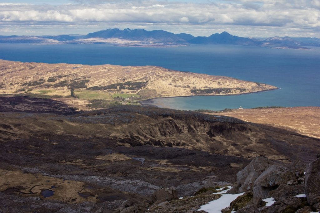 This photo shows the view over Kinloch Bay from the Cuilling hills on the Isle of Rum, and the Cuillin on the Isle of Skye in the distance.