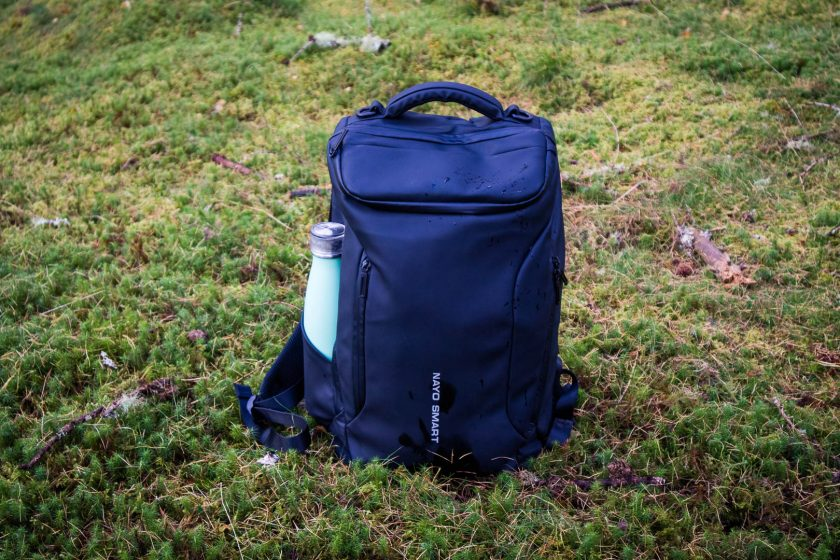 Nayo Smart backpack on the mossy forest ground