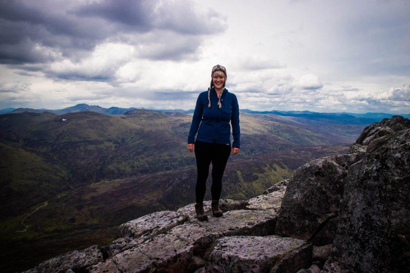 A woman in hiking on Schiehallion mountain in Scotland