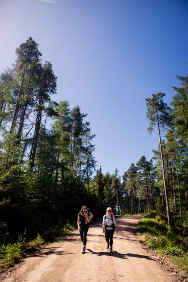 Two women hiking in a forest in Scotland