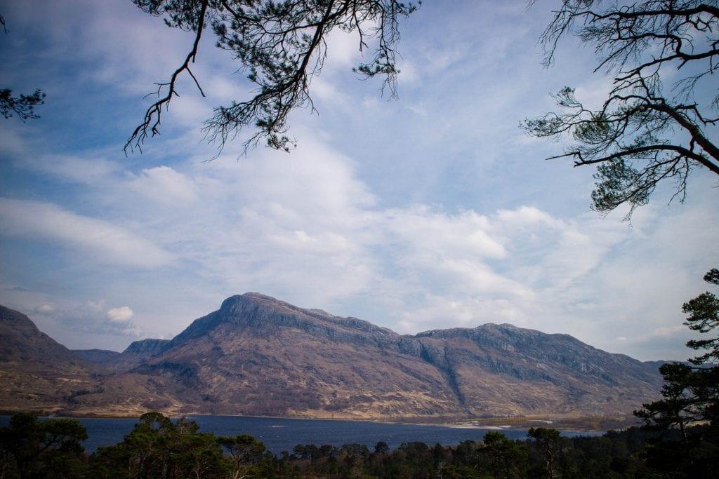 Hiking the mountain trail at Beinn Eighe in Scotland.