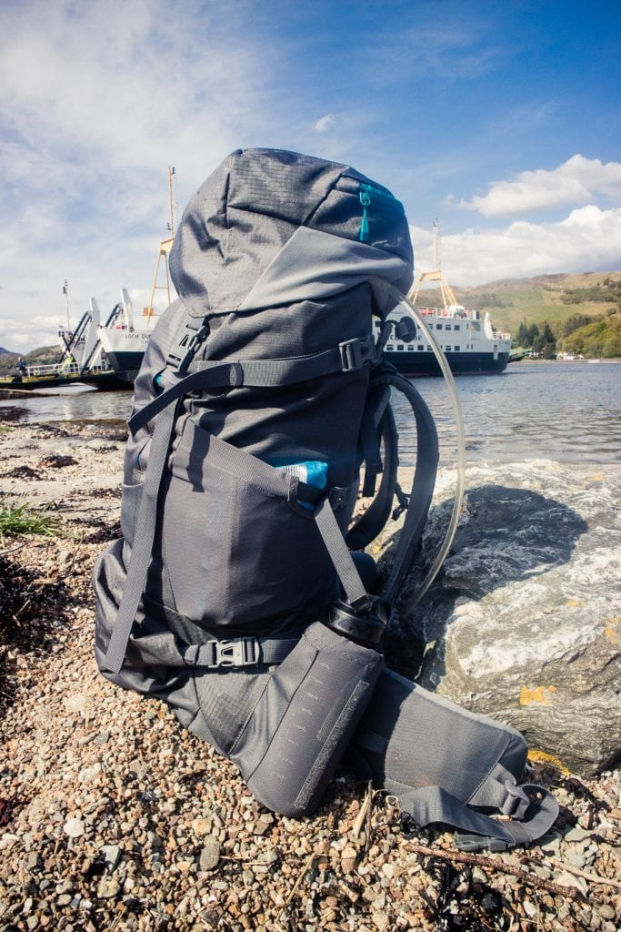 A Vaude trekking backpack by a ferry terminal in Scotland. - The best trekking backpacks & their must-have features